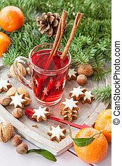 Mug of tea with christmas cookies