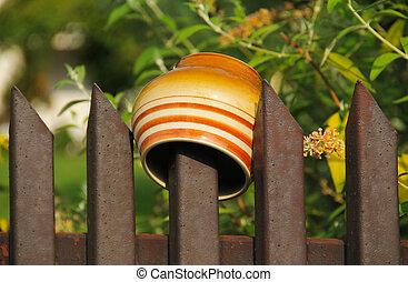 mug on the fence