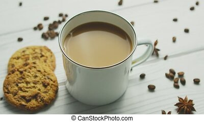 Mug with coffee and cookies