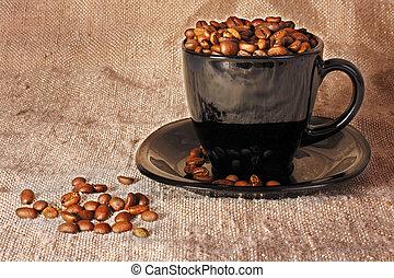 Mug with coffee beans