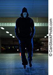 Mugger wearing mask at night - View of mugger wearing mask...