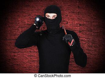 mugger with flashlight