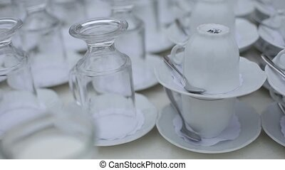 Mugs and glasses On the table in the restaurant - Mugs and...