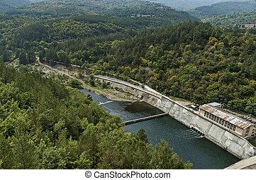 View of the old small hydro power plant and Topolnitsa dam on the river Topolnitsa near village Muhovo, Ihtiman region