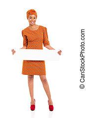 mujer africana, tenencia, panel blanco