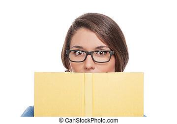 mujer, anteojos, joven, book., aislado, mirar, mientras, libro, blanco, emocionante, sorprendido, afuera