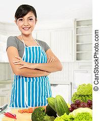 mujer asiática, cocina