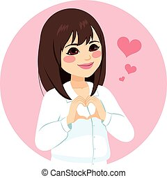 mujer asiática, forma corazón, manos