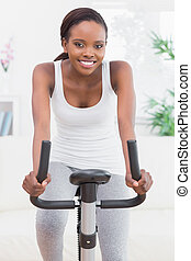 mujer, bicicleta, negro, ejercicio