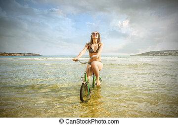 mujer, bicicleta