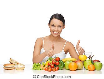 mujer, con, fruits, actuación, pulgares arriba