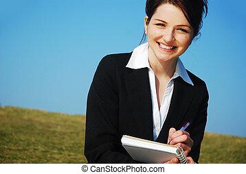 mujer de negocios, con, bloc