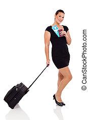 mujer de negocios, con, equipaje, bolsa, y, aire, boleto