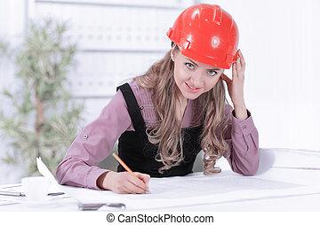 mujer de negocios, dibujo, cianotipo, en, escritorio de oficina