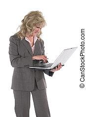 mujer de negocios, multitáreas, con, teléfono celular, y,...