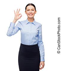 mujer de negocios, sonriente, aprobar, actuación, señal