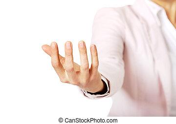 mujer de negocios, tenencia, algo, en, mano