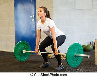 mujer, elevación, barra con pesas