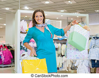 mujer embarazada, en, bebé, tienda, tienda