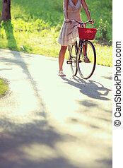 mujer, en, bicicleta