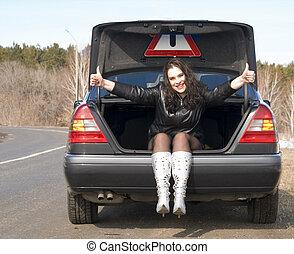 mujer, en el coche