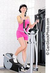 mujer, en el gimnasio