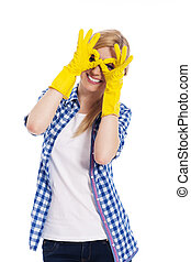 mujer, guante, mano, alegre, protector, elaboración, gesto