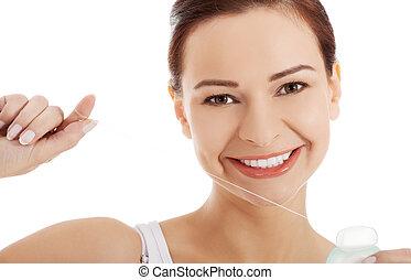 mujer hermosa, con, dental, floss.