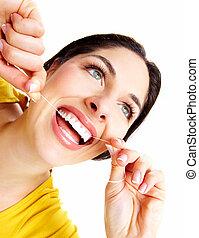 mujer hermosa, con, un, dental, floss.