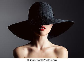 mujer hermosa, en, hat., retro, fashion., oscuridad, fondo.