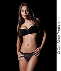 mujer hermosa, vestido, en, sexy, negro, lenceria