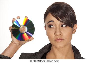 mujer, joven, cd, mirar, tenencia, magnífico, worried.