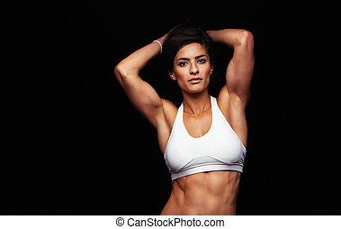 mujer joven, con, complexión muscular