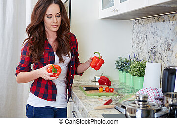 mujer joven, cooking., alimento sano