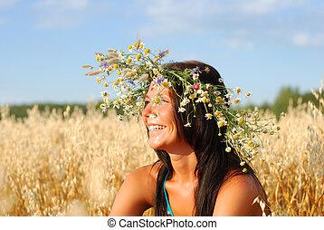 mujer joven, en, campo de trigo
