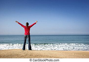 mujer joven, en, el, playa