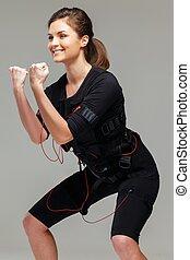 mujer joven, hacer, ejercicio, en, electro, muscular,...