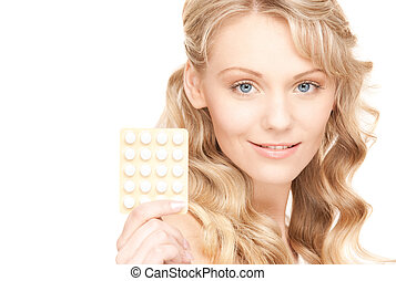 mujer, joven, píldoras