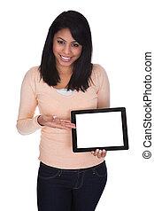 mujer joven, tenencia, tableta de digital