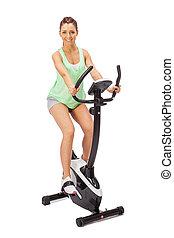 mujer joven, usos, bicicleta inmóvil, trainer.