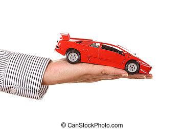 mujer, mano, con, tenencia, rojo, coche deportivo, -, aislado, blanco