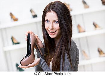 mujer, mantener, coffee-colored, zapato