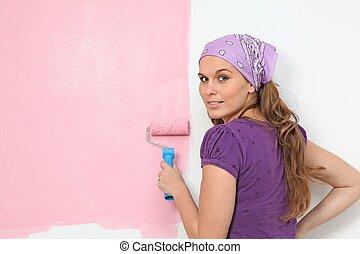mujer, pintura, y, adornar el cuarto de niños, pared