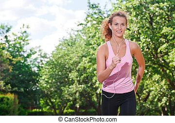 mujer que corre, en, el, park.