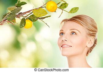 mujer, ramita, limón