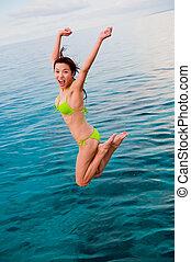 mujer, saltar
