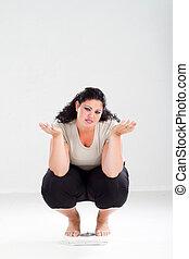 mujer, sobrepeso, escala, triste