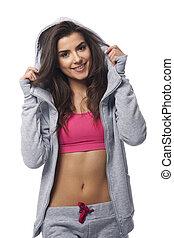 mujer sonriente, llevando, moda, deporte, ropa