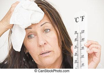 mujer, sudor, termómetro