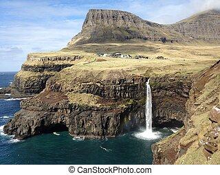mulafossur coastal waterfall